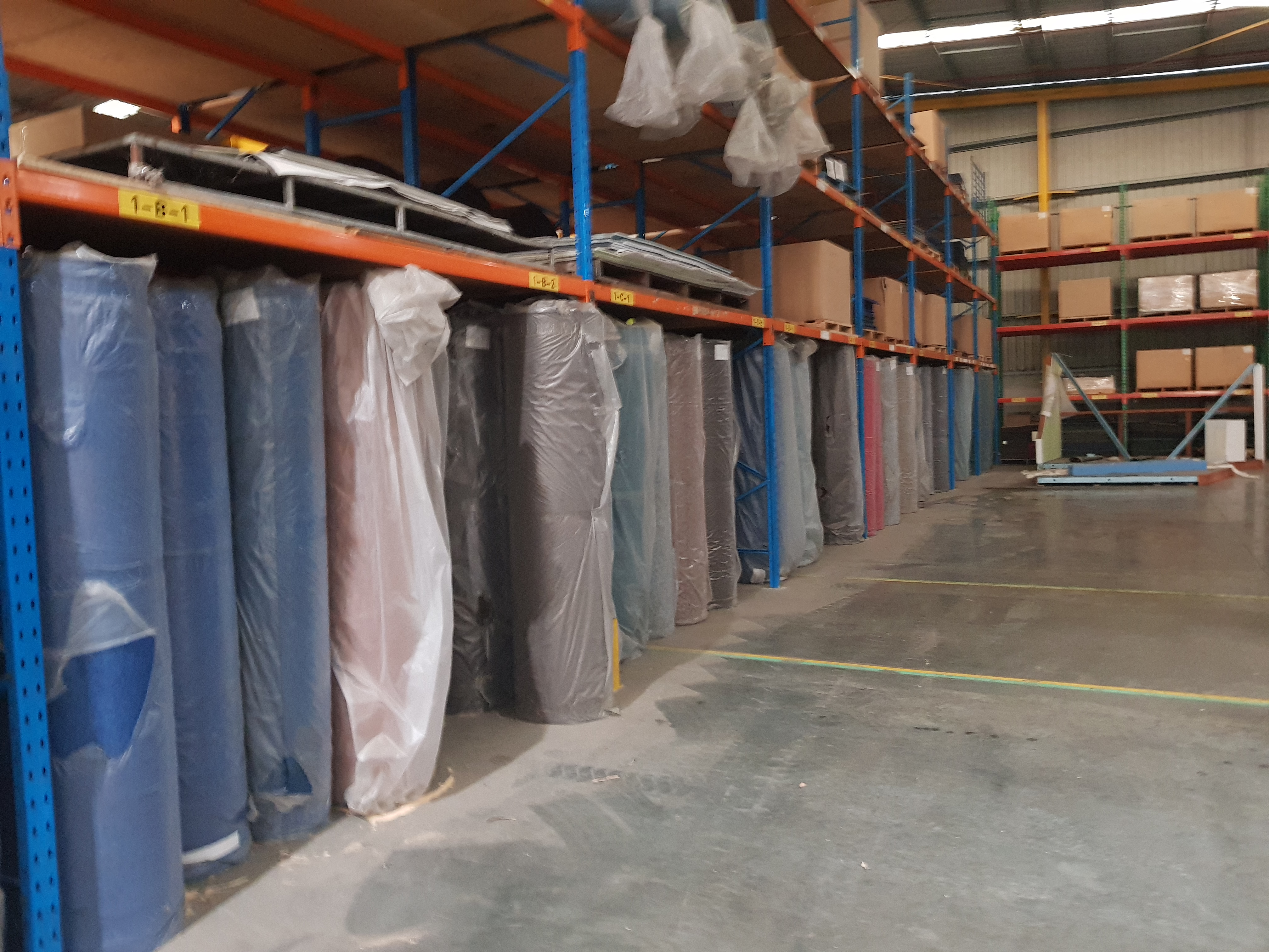 Liquidators Auction – Textile Manufacturing – Dilo Looms, Ramisch Embossing Calender, Carders, Openers, Over $1m Carpet/Carpet Tile Stock, 11 x 40' Shipping Containers, Pallet Racking, Forklift Etc.